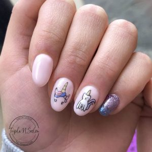 Purple glitter ombre character nail art unicorn
