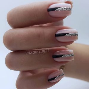 classic gel polish manicure with glitter lines